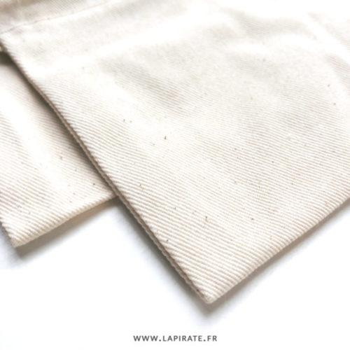 Pochons à dragées coton écru/naturel, détail fibre de coton moyenne