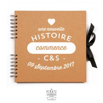 """Livre d'or Kraft et Blanc personnalisé """"Une nouvelle histoire commence"""" - La Pirate"""